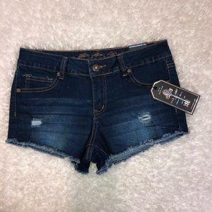 Distressed raw hem jean shorts